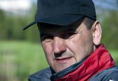 Man in a cap portrait. Portrait of a handsome man wearing a black cap stock images