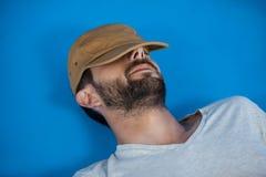Man in cap relaxing Royalty Free Stock Photos