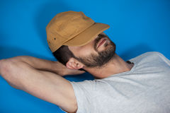 Man in cap relaxing Royalty Free Stock Photography