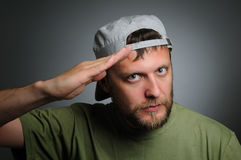 A man in a cap salutes Royalty Free Stock Image