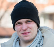 Man in a cap and scarf Stock Photography
