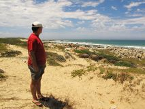 Man at Cape Recife nature reserve at Angola bay  in Port Elizabeth on Sunshine Coast, South Africa Royalty Free Stock Photography