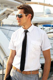 Man captain in a white shirt near the yacht, Stock Photo
