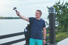 Man capturing herself with personal camera Stock Photos