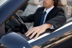 Man in car. Young man in luxury sports car Stock Photography