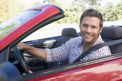 Man in car. Handsome caucasian man in cabriolet car smiling Stock Photography