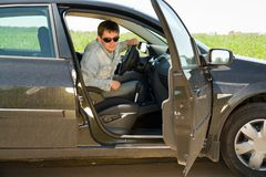 Man in the car Stock Images