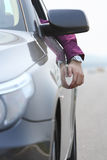 Man in the car. Arm out of the window Royalty Free Stock Photography