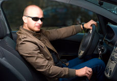 Man in a car Stock Image