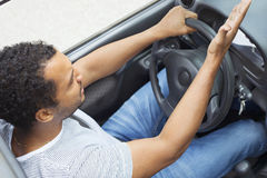 Man in car annoyed by traffic Royalty Free Stock Photos