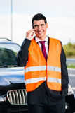 Man with car breakdown calling towing company Stock Photos