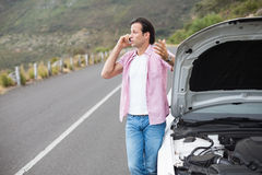 Man after a car breakdown Stock Photography