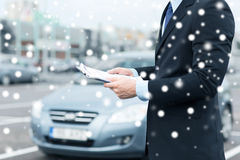 Man with car documents outside Stock Image