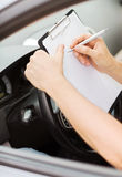 Man with car documents Stock Image