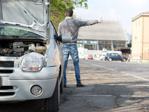 Man and car engine breakdown problem. Man hitchhiking on the road after a vehicle breakdown Stock Photo