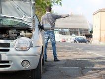 Man and car engine breakdown problem Stock Photo