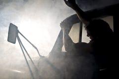 Man in car full of smoke Royalty Free Stock Images