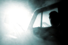Man in car full of smoke Royalty Free Stock Photos