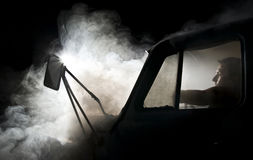 Man in car full of smoke Royalty Free Stock Photography