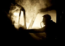 Man in car full of smoke Stock Photography
