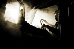 Man in car full of smoke Royalty Free Stock Images