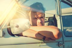 Man in a car Stock Images