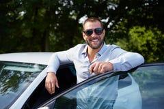 Man with car Stock Photos