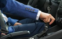 The man in the car is holding the car`s speed shift knob royalty free stock image