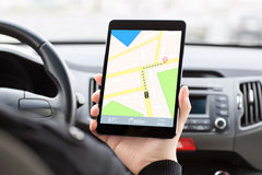 Man in the car and holding tablet with navigation Stock Photos