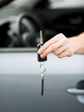 Man with car key outside Royalty Free Stock Images