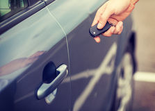 Man with car key outside Stock Photography
