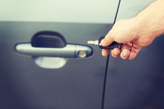 Man with car key outside Stock Photos