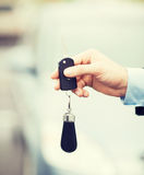 Man with car key outside Stock Images