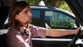 Man in car looking around waiting Royalty Free Stock Photography