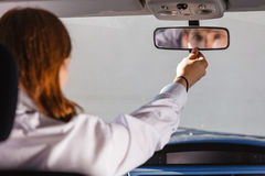 Man in car looking at mirror inside Royalty Free Stock Images