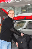 Man car luggage. Man loading bags in the trunk of his car Royalty Free Stock Image