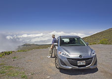 Man and car on mountain road. Hawaii, Maui Stock Image