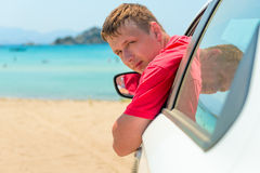 Man in car near the sea Stock Photography