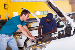 Man car repair. Man sending his car for repair in garage Stock Images