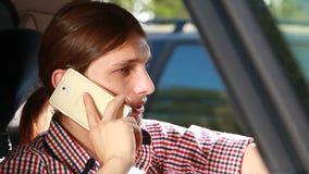 Man in car talking on phone Royalty Free Stock Photo
