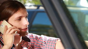 Man in car talking on phone Royalty Free Stock Image