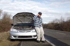 Man with car trouble Stock Photography