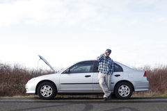 Man with car trouble Stock Images