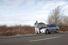 Man with car trouble Royalty Free Stock Images