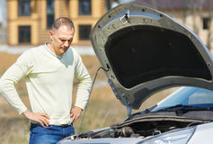 Man and car Stock Images