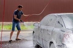 Car washing using high pressure water royalty free stock photos