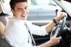 Man in car winking eye Stock Images