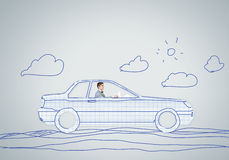 Man in car. Young man driving car made of sheet of paper Royalty Free Stock Image