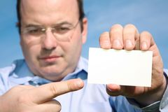 Man with card Royalty Free Stock Photos