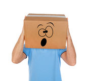 Man with cardboard box on his head and frightened emoticon face Stock Photography